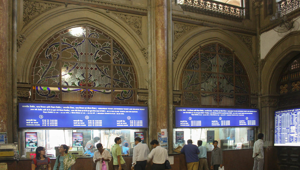 Stained glass windows above the ticket booths. Image:  © Alan Williams