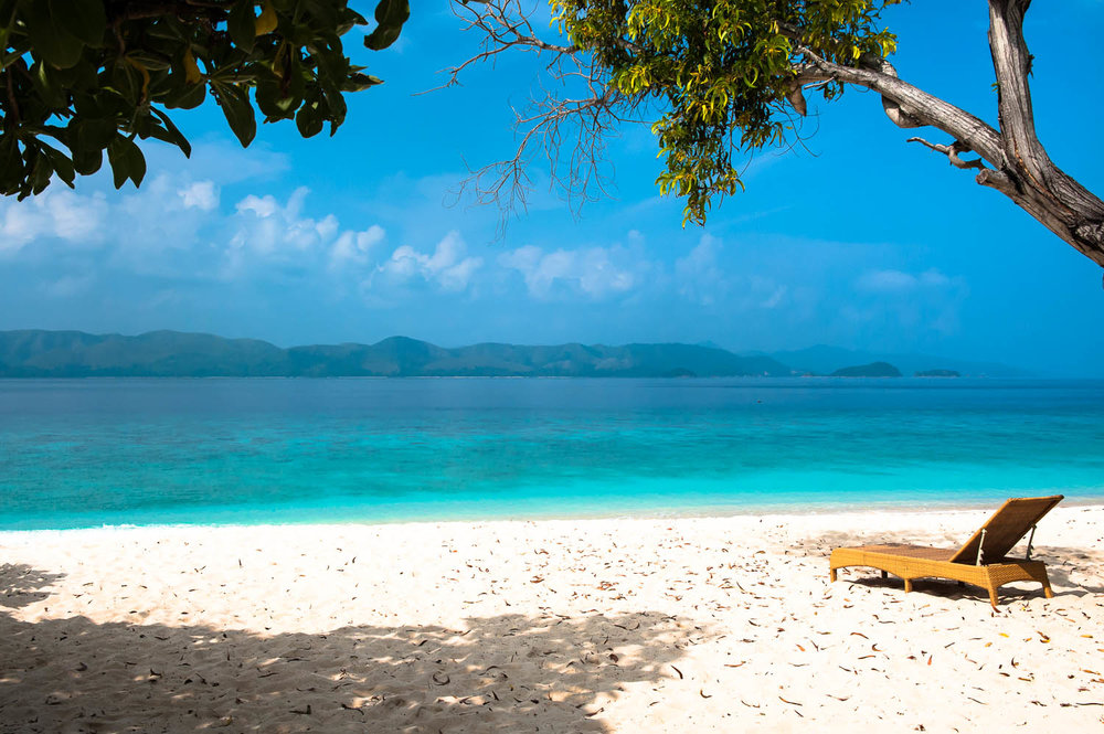The white sand and aqua blue water at Club Paradise. Image:  © David Astley