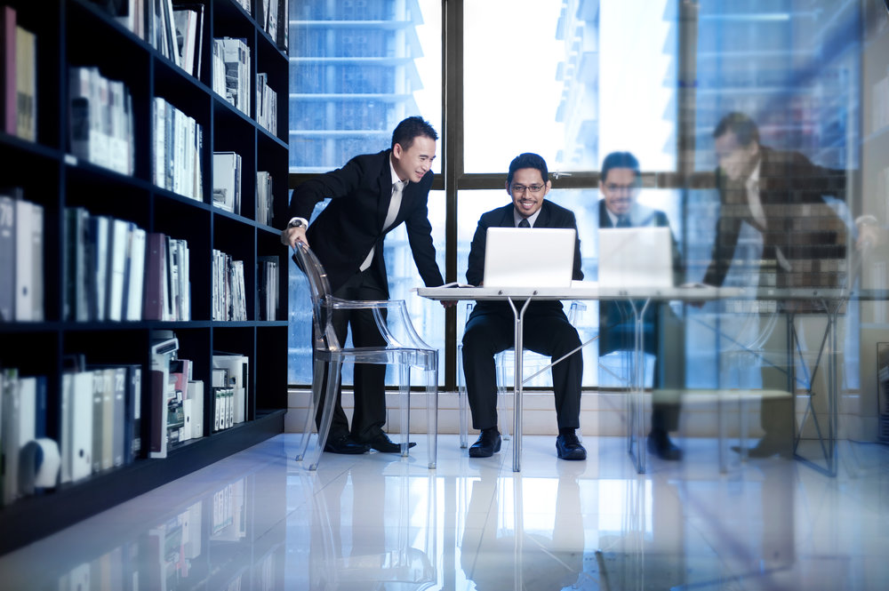 stock-photo-blur-group-of-asian-staff-working-in-operation-office-room-for-customer-support-service-concept-400749883.jpg