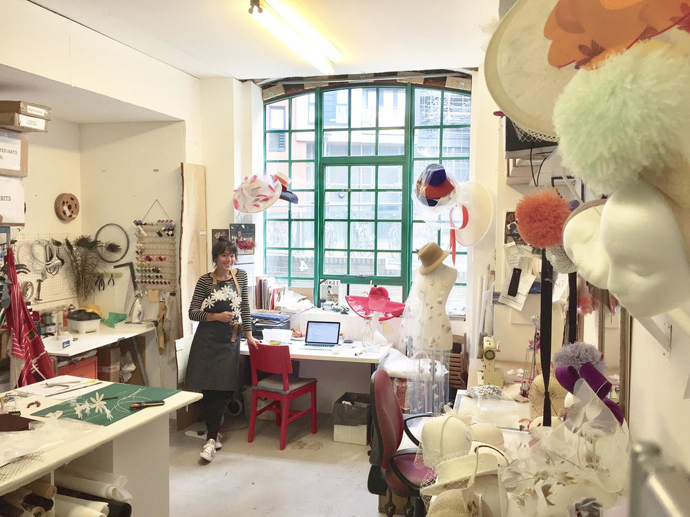 Awon from East London listens in her millinery studio.