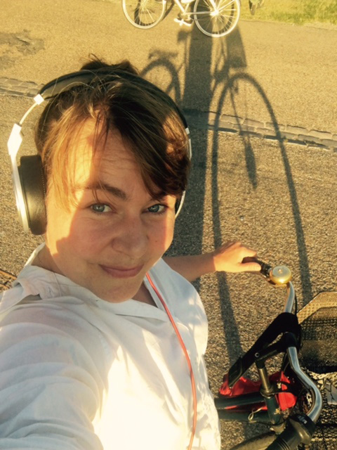 Sara listens while riding her bike in Copenhagen.