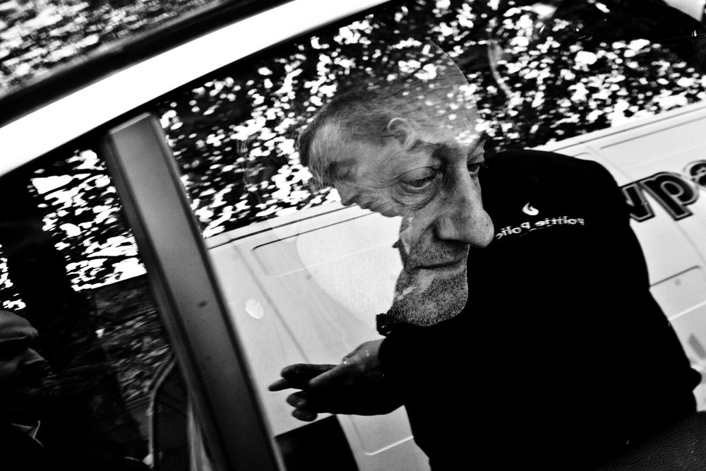 Portrait of a suspect in a police car, during a control of the police on his vehicle, Brussels, Belgium on may 2010.