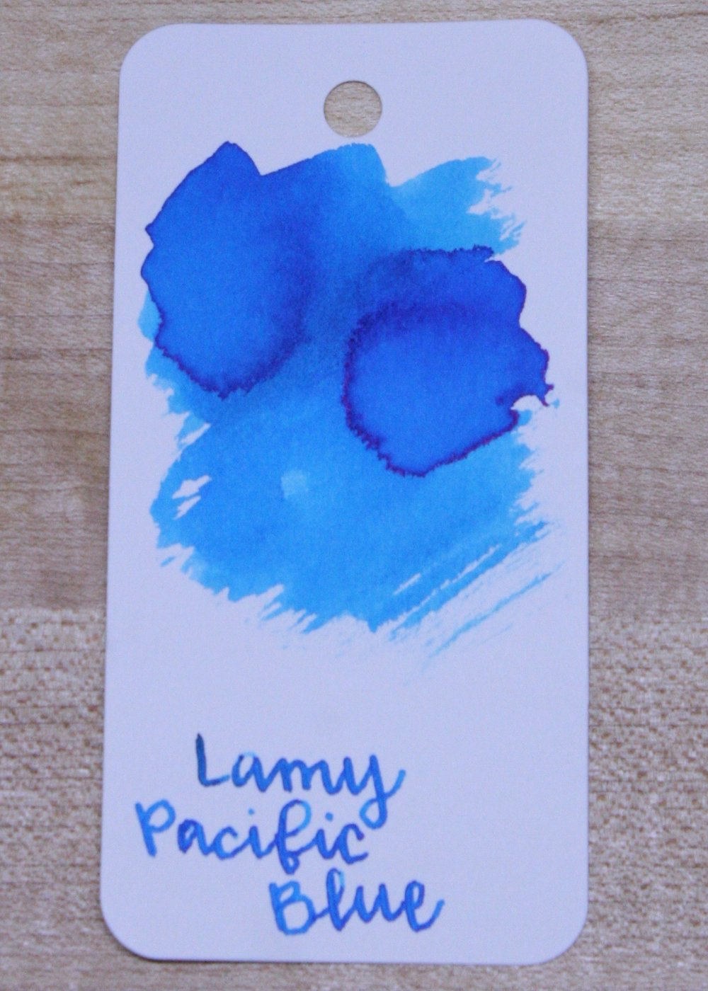 The color... - The ink is a beautiful blue, that gives off a red/pink sheen when concentrated. I love to coordinate my ink colors by season, and this would be a perfect summer blue.