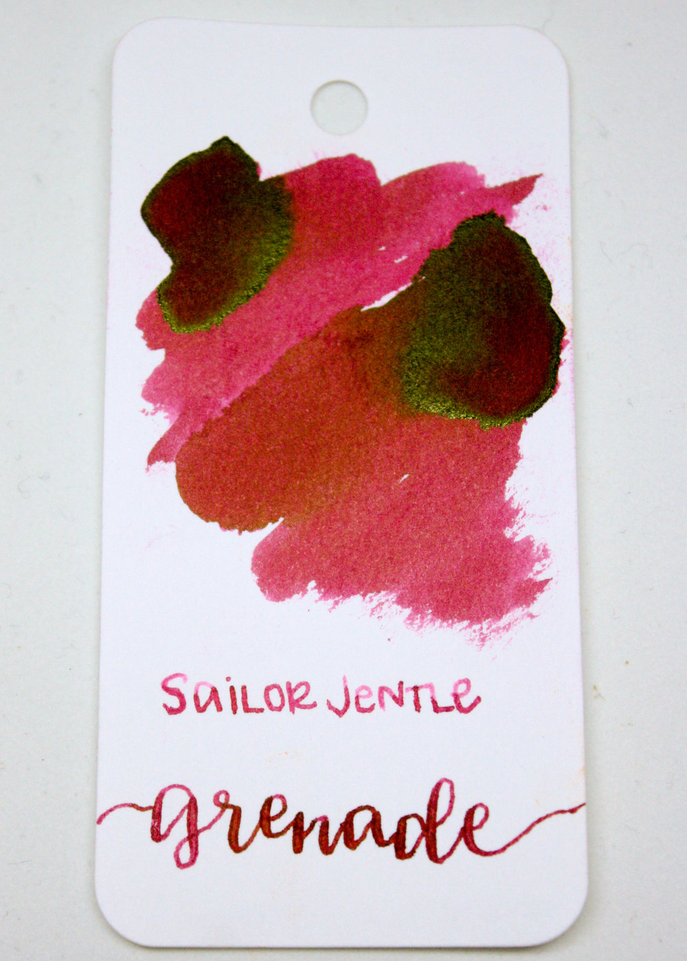 The color... - This ink is a really gorgeous pomegranate color. It's not quite red, but it's not pink either, with a beautiful gold sheen.Seasonally, I would use this ink in the fall.
