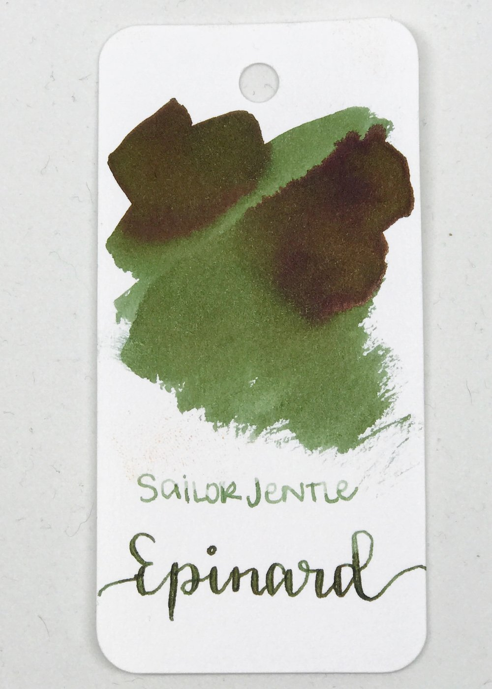 The color:  - Epinard is a spinach green color, with a red/brown sheen that shows on certain papers.
