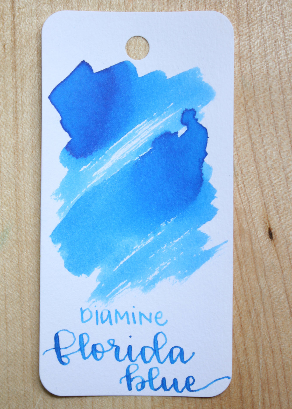 The color... - Florida Blue is a medium blue with no shading or sheen. Seasonally, I think it is a summer ink.