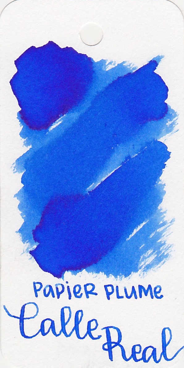 The color... - Calle Real is a royal blue with a tiny bit of sheen.