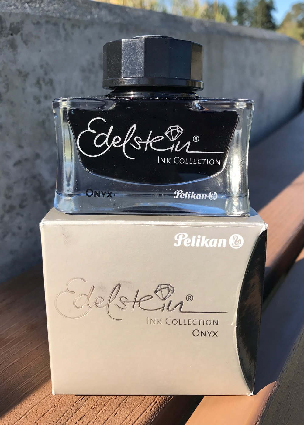 The bottle: - Pelikan Edelstein bottles look amazing. They are made of glass, and have a heavy, solid base. They aren't necessarily the best for filling pens, but they are beautiful.