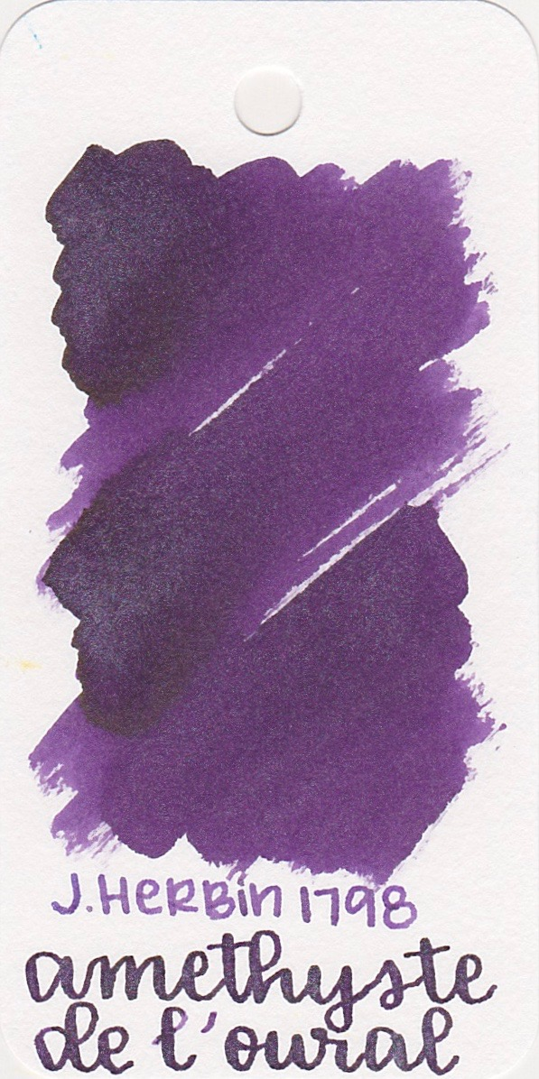 The color... - Amethyste is a dark purple with lots of silver shimmer.
