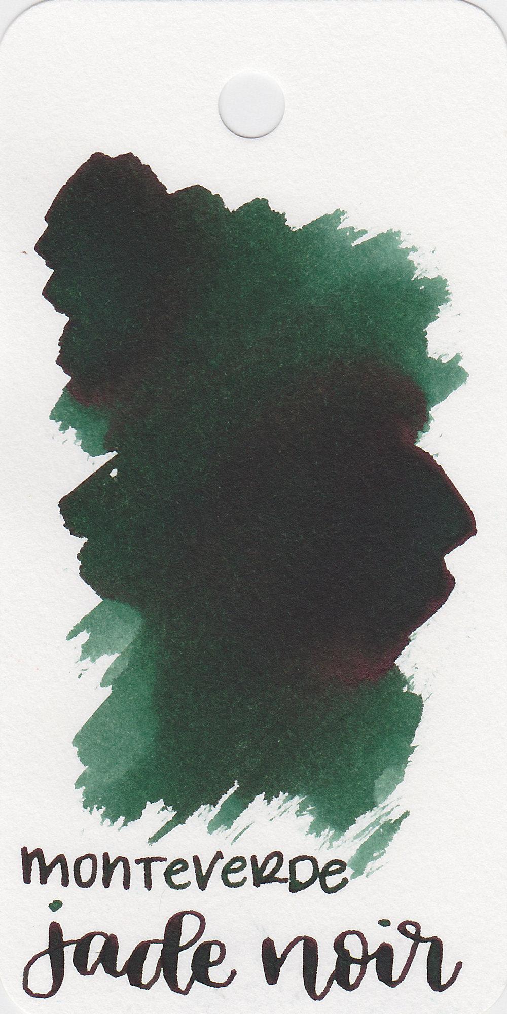 The color: - Jade Noir is a dark green.