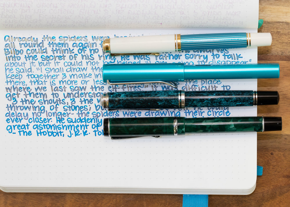 I used a broad Pelikan M600 Turquoise with the Gold version, a medium Lamy Al-Star Pacific Blue for the Silver version, a broad Pelikan M805 Ocean Swirl for the Bronze version, and a broad Conklin Durograph Forest Green for the Copper version.I think I prefer the silver version out of the four. All had some clogging issues, even with the wet flow.