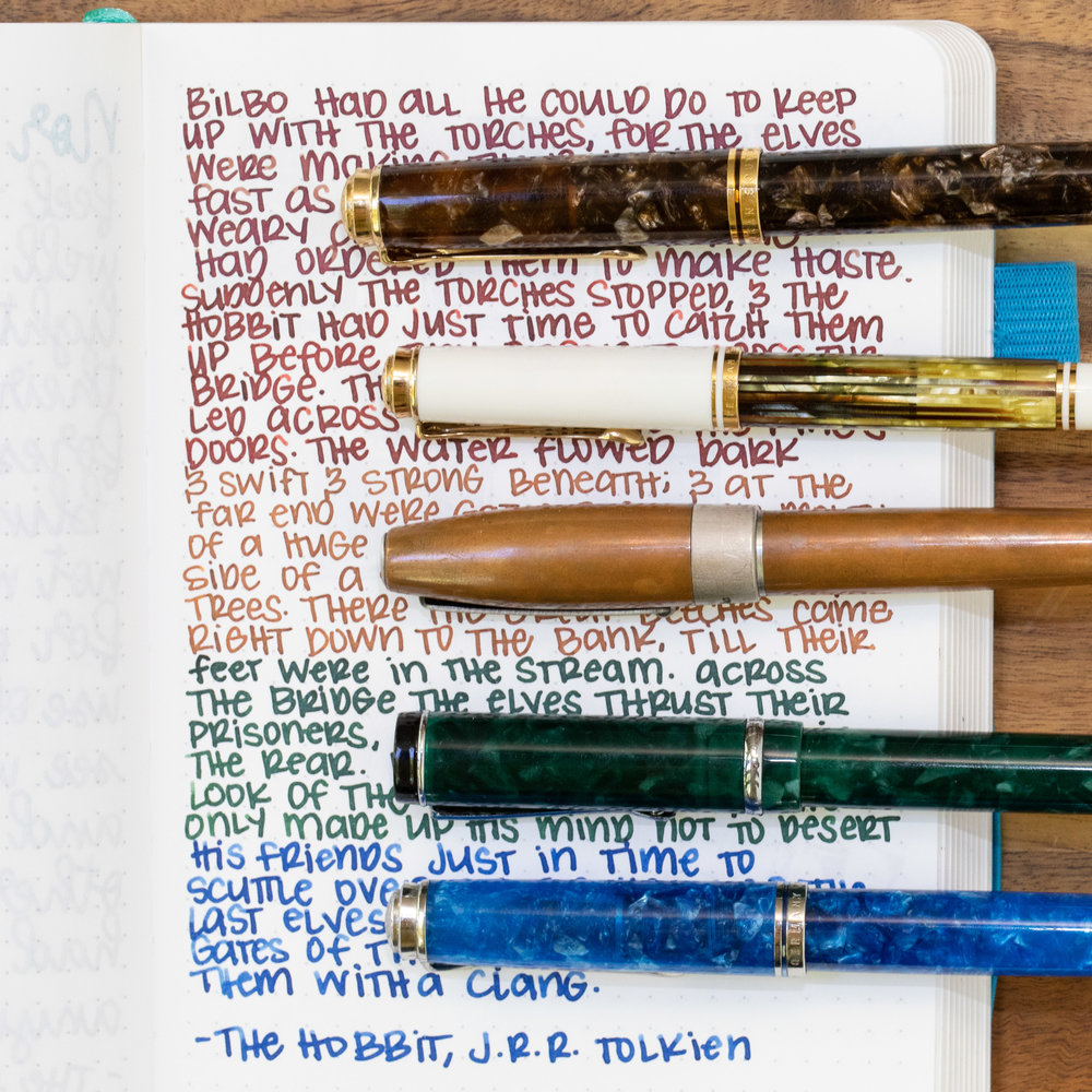 I used an ivory Hippo Noto notebook (Tomoe River 68gsm). Top to bottom, I used: Pelikan M800 Renaissance Brown, medium nib, Pelikan M400 White Tortoise, medium nib, Montegrappa Copper Mule, fine nib, Conklin Durograph Forest, broad nib, and a Pelikan M805 Vibrant Blue, broad nib. All of the inks had an average flow except for Sisters Azure, which was a little bit dry.