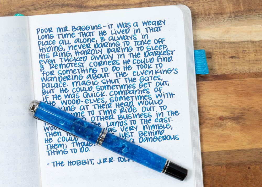 I used a broad Pelikan M805 Vibrant Blue on an ivory Hippo Noto Notebook. The ink had a nice wet flow.