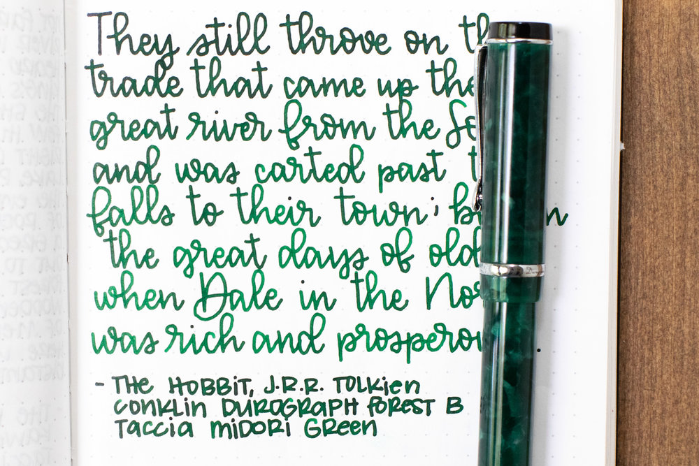 I used a broad Conklin Duragraph Forest Green on Tomoe River 68gsm. The ink had a wet flow.
