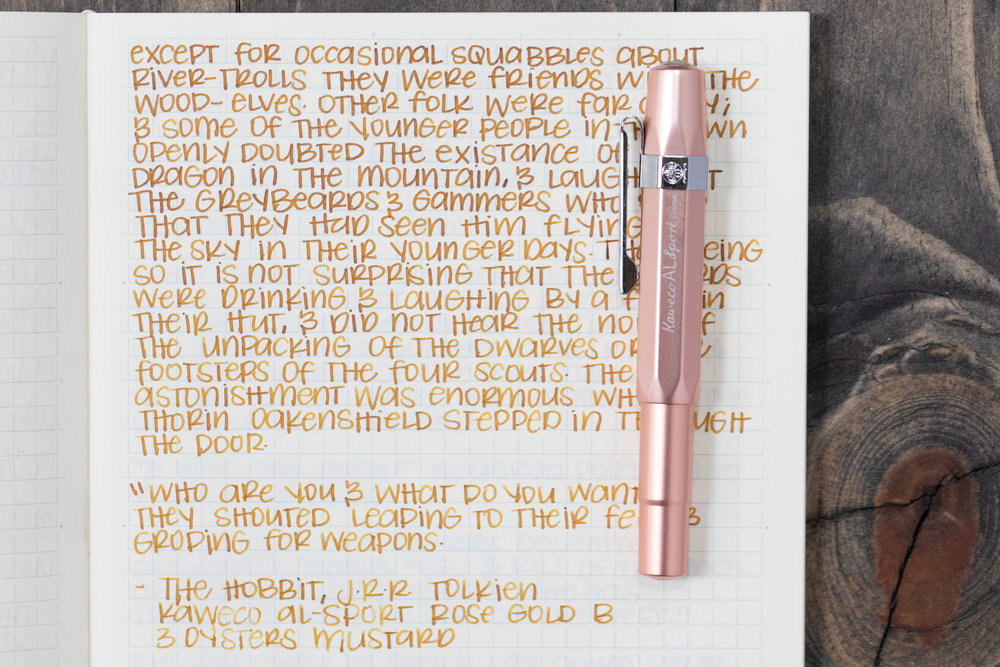 I used a broad Kaweco Al-sport Rose Gold on a Midori MD Notebook. The ink had a dry flow, but did not have any skipping issues in this pen.