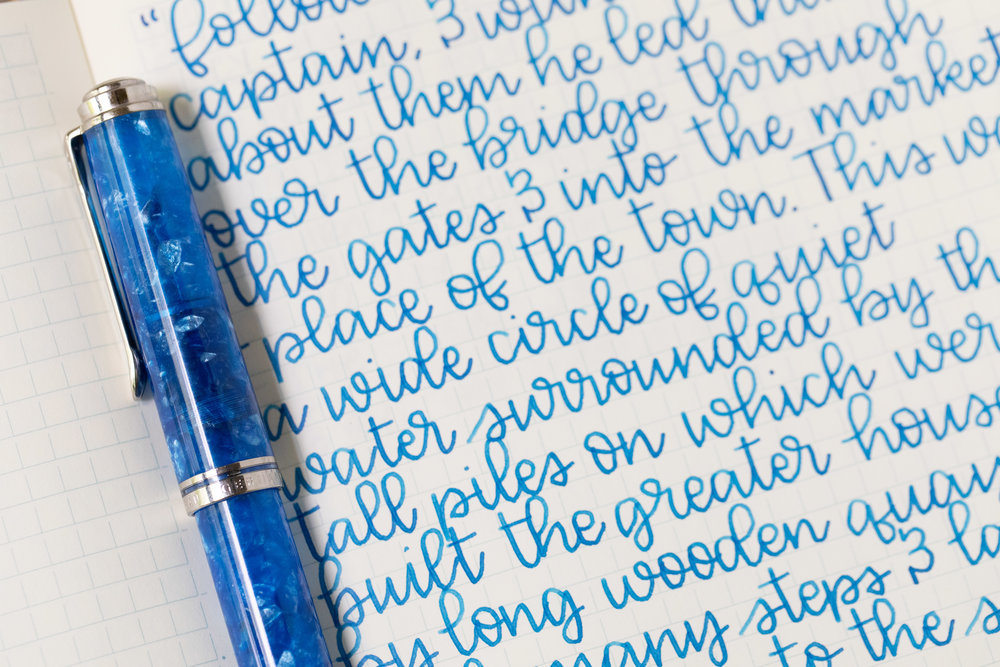 I used a broad Pelikan M805 Vibrant Blue on a Midori MD Notebook. The ink had a dry flow.