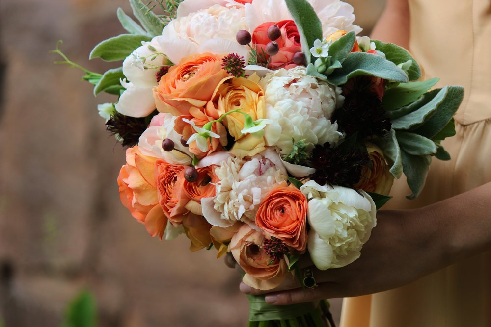 Orange, peach, and white spring/June wedding bouquet with lambs ear