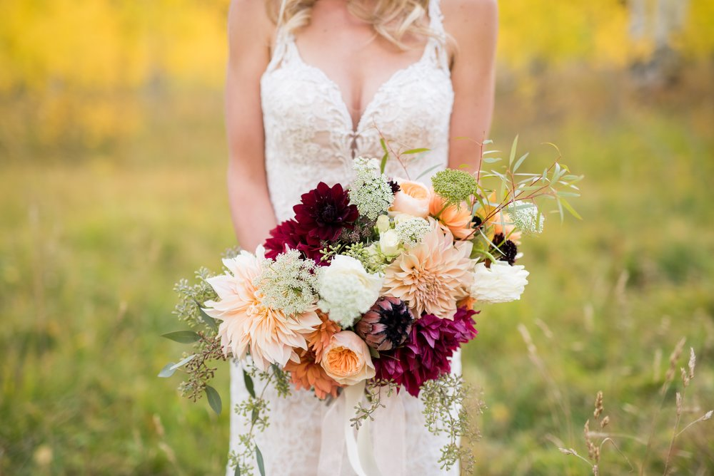 Gorgeous wedding bouquet with dahlias- peach and burgundy