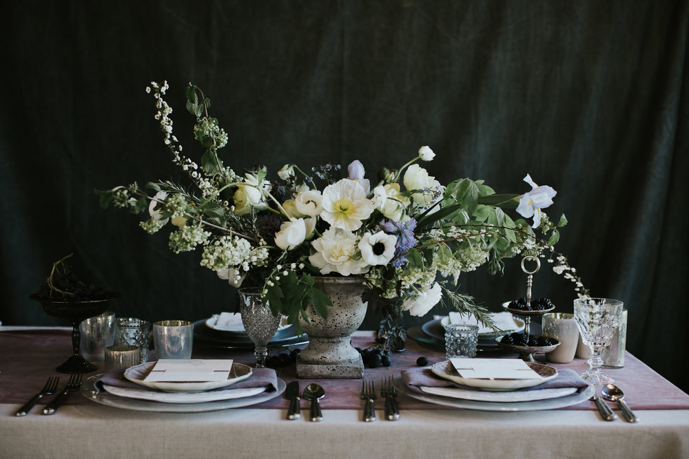 Tablescape with white spring floral arrangement.