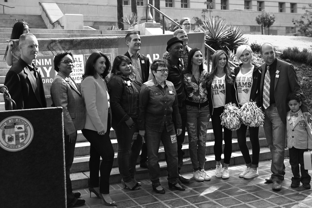 Stephanie Wiggins, Councilmember Nury Martinez, Claudia Batres-Flores, Mayor Eric Garcetti, Patti Giggans, Denim Day spokescouple Aloe Blacc and Maya Jupiter, LA Galaxy legend and Director of Girls' Academy Kevin Hartman, LA Rams Cheerleaders, former LAUSD Board President Steve Zimmer and other community members gathered for a Denim Day press conference at LA City Hall.