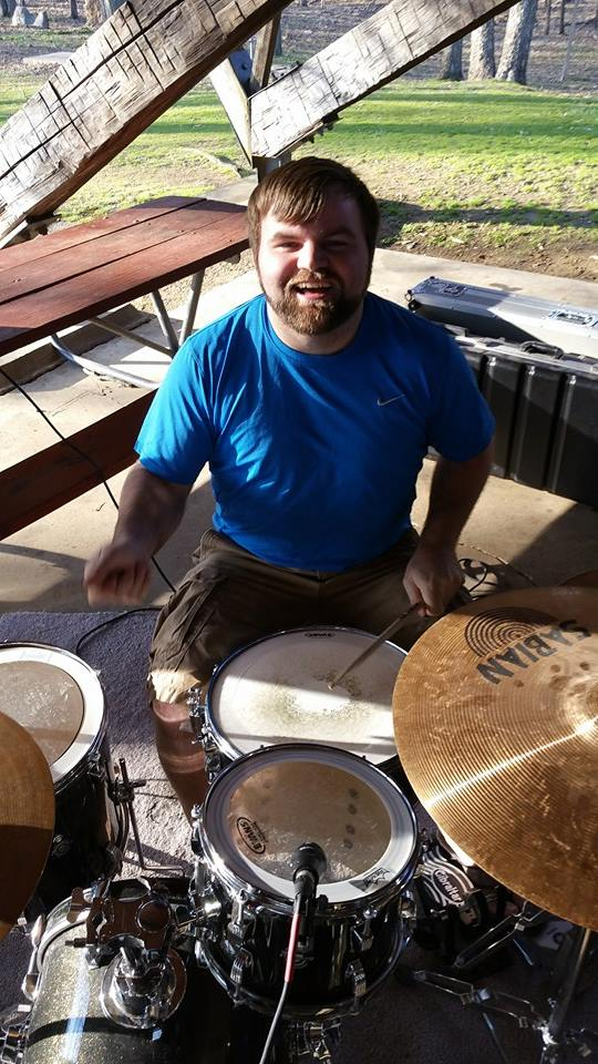 """Jarade Wrobel   Jarade, or as we call him, """"Happy Sticks,"""" brings the thunder as the sultan of slam for LRC Alive! You'll catch him groovin' on Sunday mornings on his custom built Ludwig drum kit and Sabian cymbals. (Just look at that beard!)"""