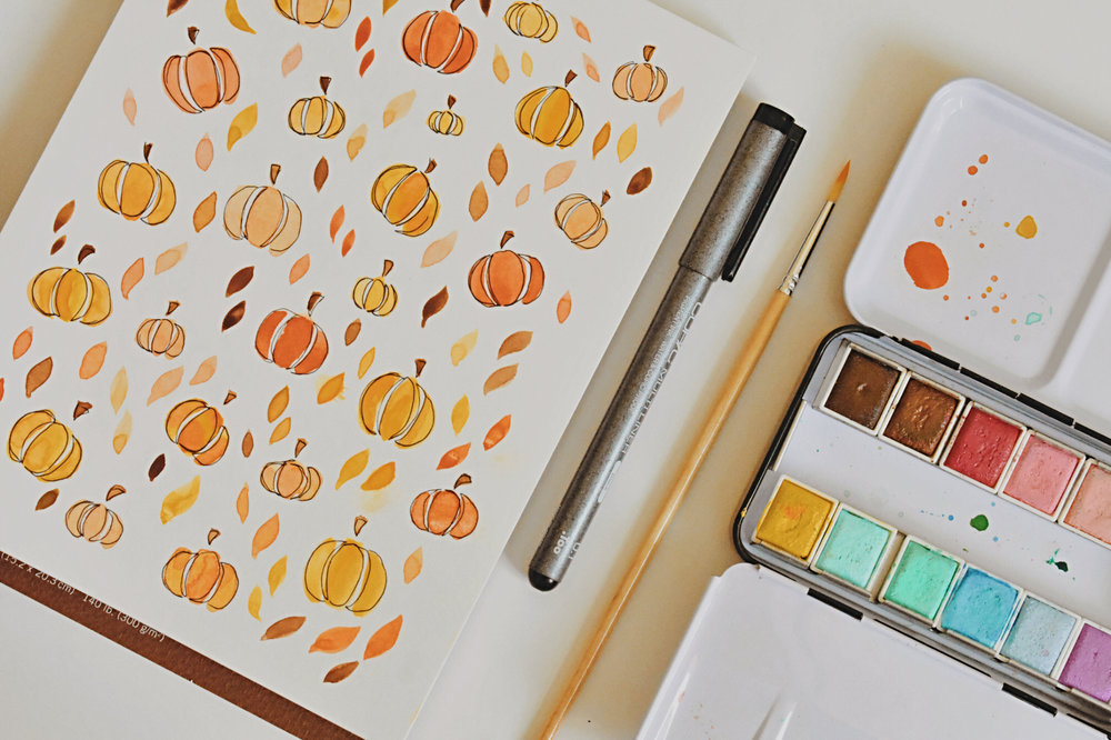 I loved getting to create little fall pieces for my work space. For materials I used Prima Watercolors, Strathmore watercolor paper, Copic Multiliners, and round brushes I found at Hobby Lobby.