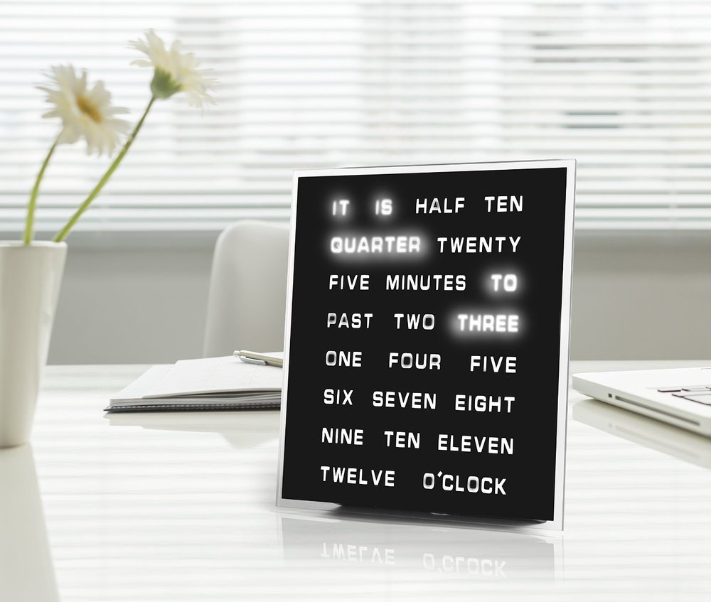 Led Word Clock - Upgrade your digital clock to a unique Led Word Clock. The awesome timepiece is a set of words which are selectively highlighted to show you the correct time. Perfect for your office table or you can mount it on the wall. It's easy to set up, the clock comes with an AC adapter and there's a button on the side to configure the time. This word clock will let you look at the time differently.