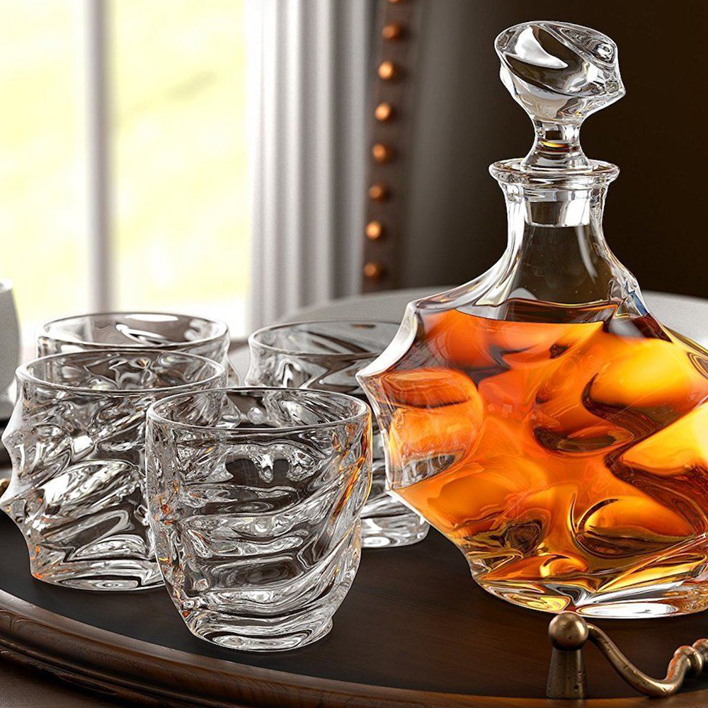 Everest Whiskey Decanter - Add some classy and artistic display to your home bar with the Everest Whiskey Decanter. The incredible craftsmanship piece comes in an embossed magnetic closure gift box with four elegant glass and a decanter that can hold up to 800ml. The glass is wide enough to put some whiskey stones or ice cubes to keep your beverage chilled. This decanter is perfect for occasions all year round.