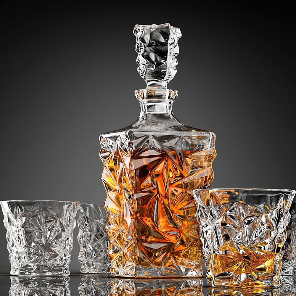 Diamond Cut Whiskey Decanter - Another beautiful Diamond Cut Whiskey Decanter made by Ashcroft Fine Glassware. This glass decanter is a showpiece for any bar. Beautifully designed stunning clear edges that is all 100% Lead-free. The Diamond Cut Decanter comes with four extra glasses and a classy stopper. It is also packaged with an embossed magnetic closure gift box, ideal present for your close friends and family.
