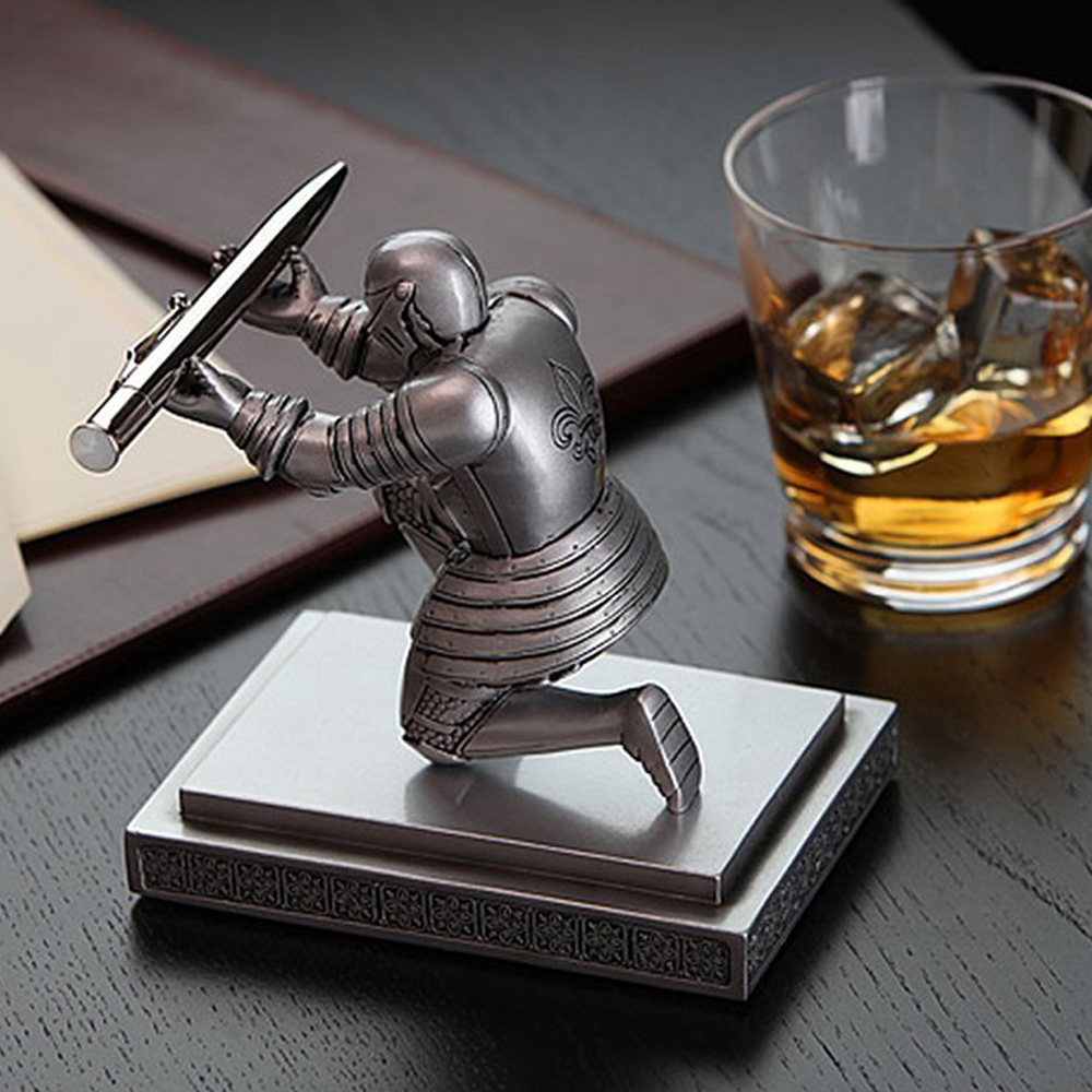 Executive Knight Pen Holder - Never lose your pen again, the Knight is always ready to hold your pen at your will. Also, the Knight Pen holder comes with a fancy black inked pen with a refillable ink.