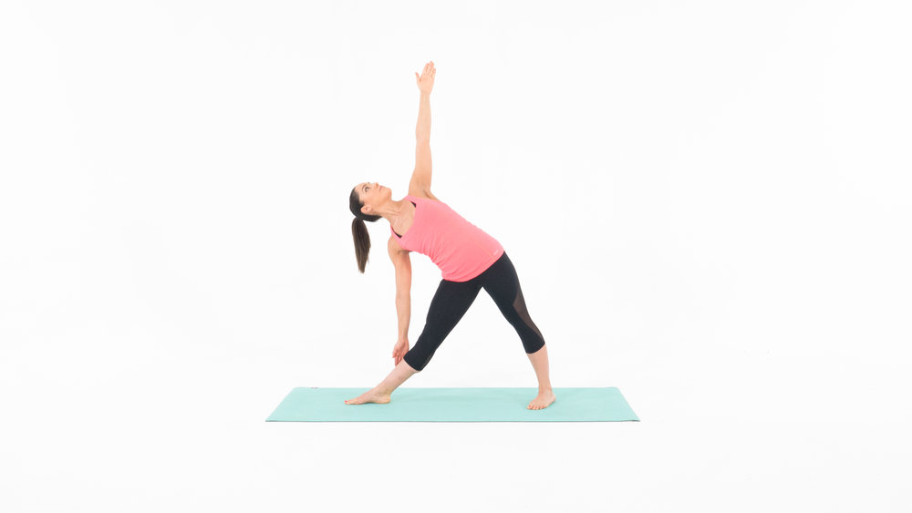 Target Muscles: Shoulders, Obliques, Hamstrings 1. Start in the standing position with your feet shoulder width apart. 2. Step out with your right leg, and turn your toes out away from your body. 3. Keeping your legs straight, reach your right arm towards your right ankle, with your palm facing out. Reach your left arm up towards the ceiling, forming the shape of a triangle.  4. Hold for 30 seconds and repeat on your opposite side.