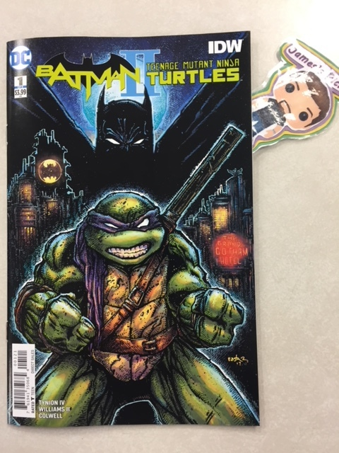 Batman/Teenage Mutant Ninja Turtles II #1 (of 6) - James's PickThe team behind the smash-hit crossover series is back to reunite the Dark Knight and the Heroes in a Half-Shell. When Donatello goes looking for a new mentor to help him improve his fighting skills, he opens a doorway to another reality, hoping to summon the Turtles' one-time ally, Batman. But instead, he gets sent to Gotham City and someone else comes through the open portal-Bane! Suddenly, there's a new gang boss in New York and he's out to unite all the other bad guys under him. Can Donnie get back in time and bring Batman with him to help his brothers before Bane causes irreparable destruction? Co-published by DC Comics with IDW Publishing.