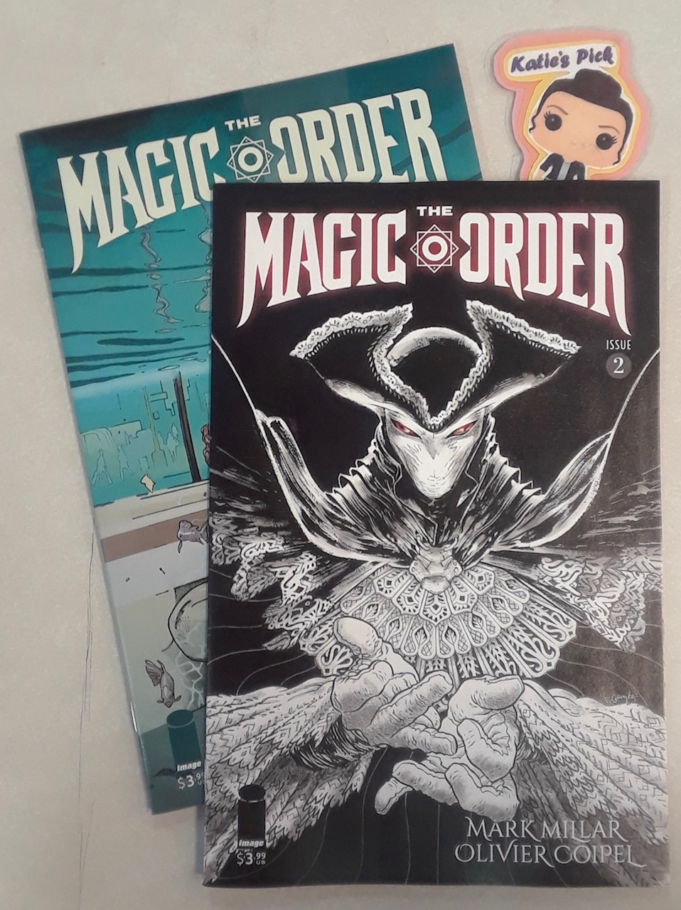 Magic Order #2 (of 6) - Katie's PickWritter: Mark MillarArtist: Oliver CoipelColorist: Dave StewartLetterer: Peter Doherty A dark force is targeting The Magic Order, killing off its members one by one. Time is running out, and the death toll is rising. Will Gabriel return to the fold to save his family, and the world, from the forces of evil?
