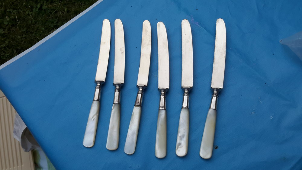 Silver knives with ivory handles.jpg