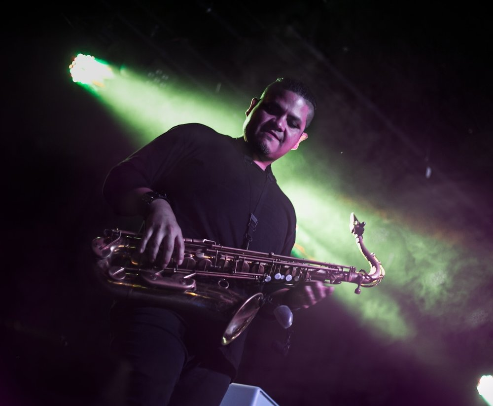 "Featuring - Saxophone virtuoso Miqui G on half of  the songs on ""No Dancing"" with his expansive pedal board work and mind bending solo sections."