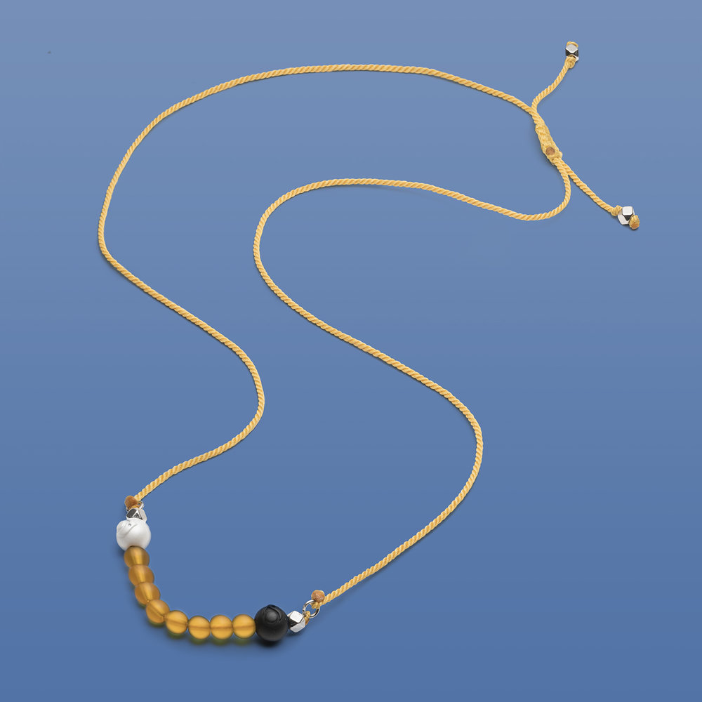 canary yellow necklace blue background with less gradient.jpg