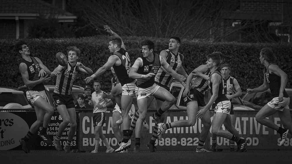 Chaos reigns for much of the time in an Australian Rules football match. The players role is to try to make some sort of sense out of it.