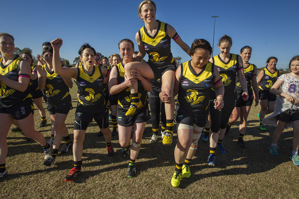 Veteran women's AFL player Tracey Ashley is chaired off the ground following a final win against Coburg after announcing her retirement.
