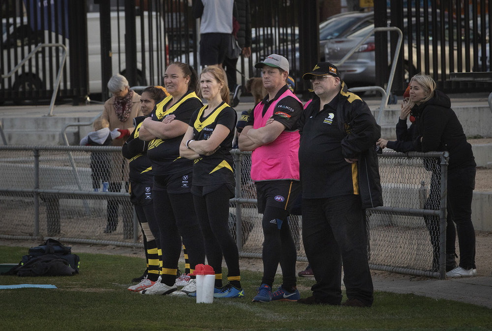 Robyn Nichols watching a tight contest on the sidelines with the coaching staff during a game against Coburg at its home ground of Piranha Park in the northern suburbs of Melbourne.