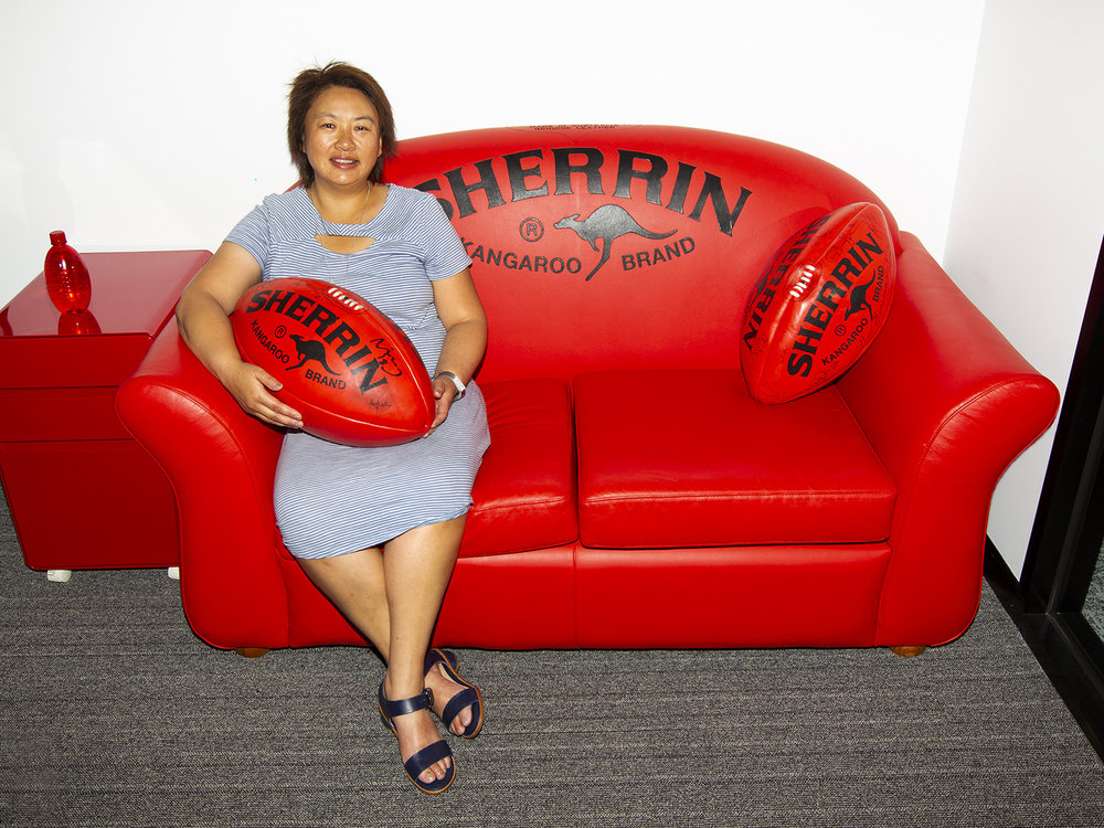 The CEO of the South Metro Junior Football League is so keen on Australian Rules she has a custom-built Sherrin couch in her office. It helps to give visitors some idea of her dedication to the sport!