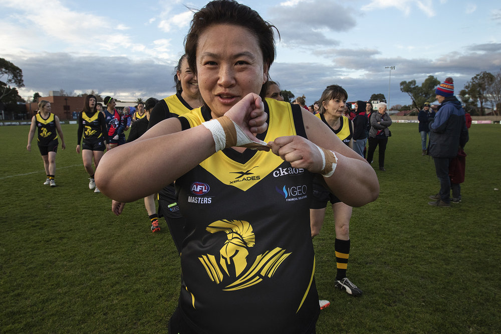 The joy of playing is evident as Loh leaves the ground after a tight finish against Coburg.