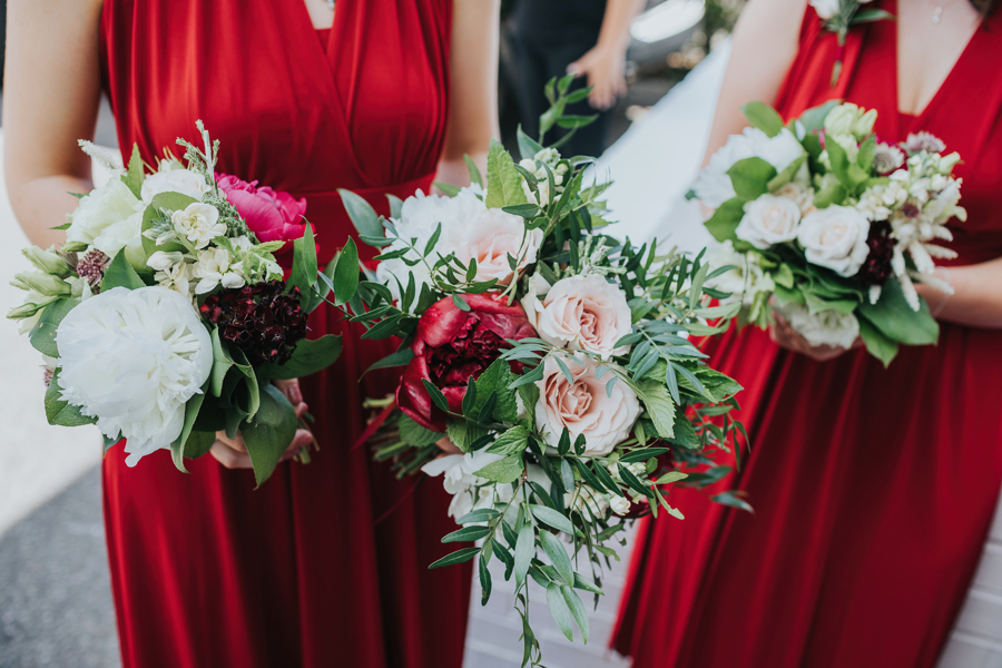The Bridesmaids wore red dresses which picked out the fabulous Red British Peonies in the Bouquets....