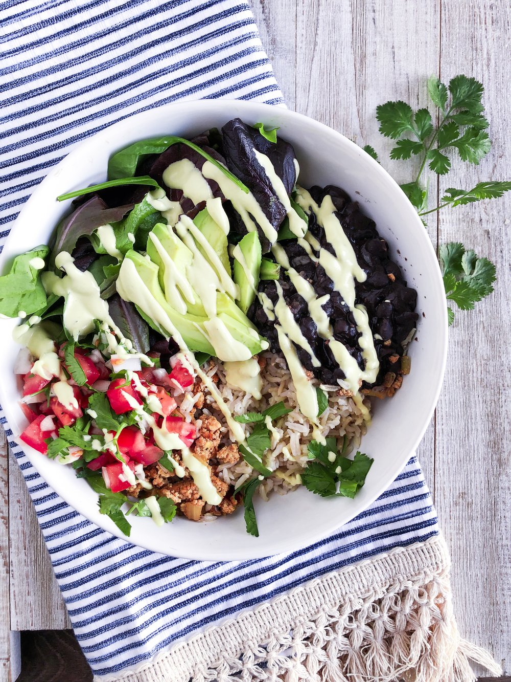 Chipotle style Rice Bowl with Sofritas - Plant-based, vegan, and delicious. Download the recipe and others in this FREE 7-Day Meal Plan and grocery list. #plantbased #vegan #healthyeating #freedownload #cleaneating #chipotle #ricebowl