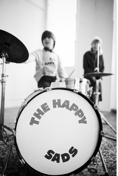 Bobo Choses proudly presents the coolest kids'band ever, The Happysads!  They sing about how confusing it can be to be a kid. One minute they're happy,sad the next, or jumping and laughing wildy and then all of a sudden caught up in the throws of a temper tantrum.Bobo Choses AW '18-19 collection is inspired by kids and their way of expressing conflicting emotions. Sometimes they can't express their feelings, let alone, put them into words. The collection is full of playful contradictions: YES/NO, Clearly Confused and the most telling: The Happysads!  So the next time they need some cheering up, bring out the band and start playing & dancing!