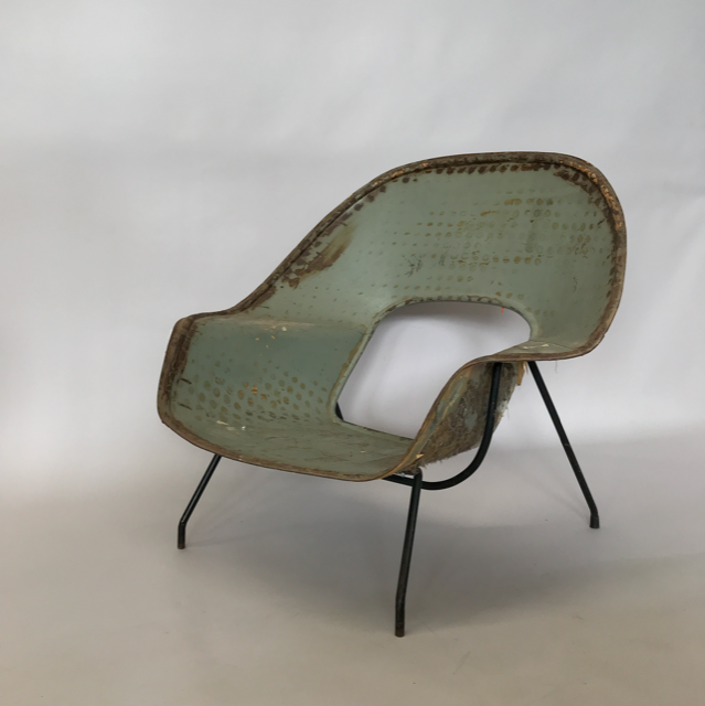 An Early Metal Prototype of the Womb Chair - part of the Tom Gibbs Studio Collection. On view through January.