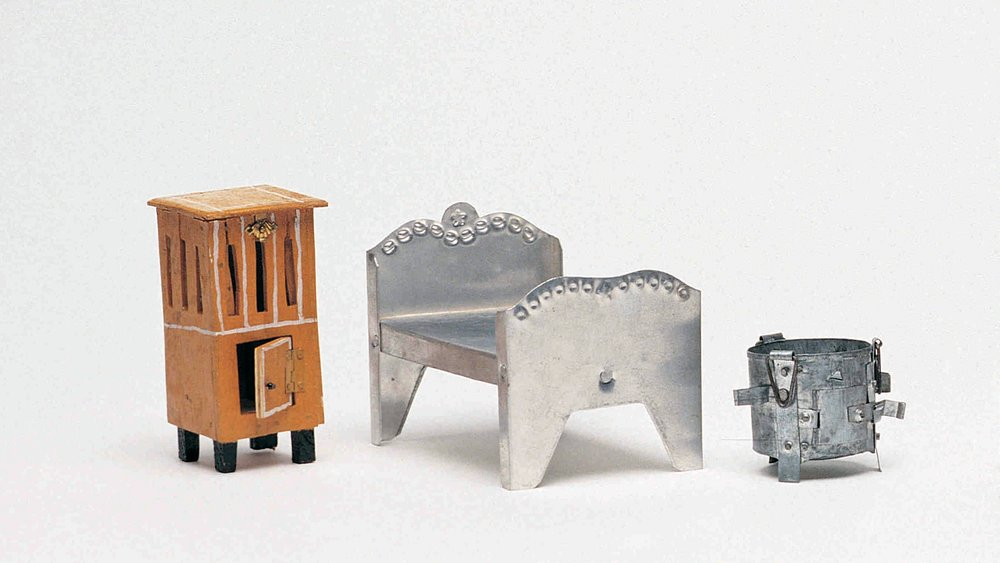 toy miniatures made from wood, aluminium and tin