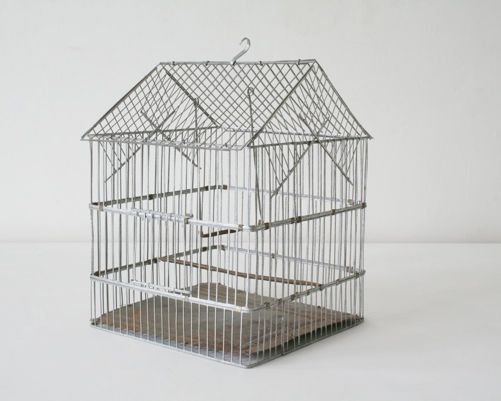 Birdcage made from stamped out steel