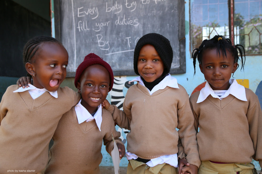Above: Four friends at Gloryland Prep School, Tanzania.