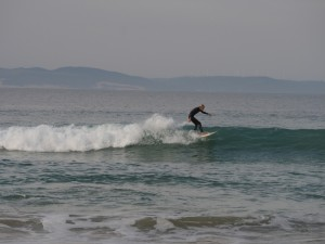 Local surfer riding the waves in Jbay