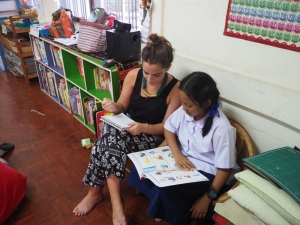 One of the volunteers helping a student with her work